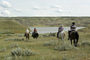 Riders on the prairie head towards the South Saskatchewan river