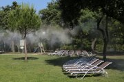Water vapour sprays over loungers near the poolside