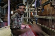 A weaver at his loom in the village of Tangail, Bangladesh