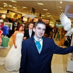 Bridal Fayre at Debenhams at Eagles Meadow, Wrexham. Bride Lauren Raybould, groom Dominic Baxter waits for Whisper the Barn Owl to bring the wedding rings.